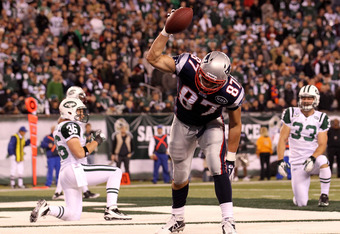EAST RUTHERFORD, NJ - NOVEMBER 13:  Rob Gronkowski #87 of the New England Patriots celebrates after scoring a touchdown late in the second quarter against the New York Jets at MetLife Stadium on November 13, 2011 in East Rutherford, New Jersey.  (Photo by