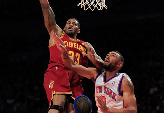 NEW YORK, NY - FEBRUARY 29: Alonzo Gee #33 of the Cleveland Cavaliers lays the ball up over Jared Jeffries #9 of the New York Knicks and Baron Davis #85 of the New York Knicks at Madison Square Garden on February 29, 2012 in New York City. NOTE TO USER: U
