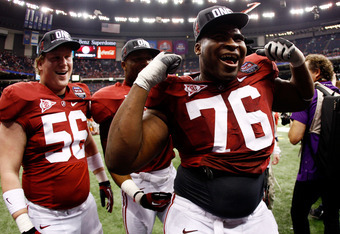 NEW ORLEANS, LA - JANUARY 09:  D.J. Fluker #76 and William Ming #56 of the Alabama Crimson Tide celebrate after defeating Louisiana State University Tigers in the 2012 Allstate BCS National Championship Game at Mercedes-Benz Superdome on January 9, 2012 i