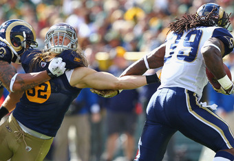 GREEN BAY, WI - OCTOBER 16: Clay Matthews #52 of the Green Bay Packers tries to tackle Steven Jackson #39 of the St. Louis Rams at Lambeau Field on October 16, 2011 in Green Bay, Wisconsin.  The Packers beat the Rams 24-3.  (Photo by Dilip Vishwanat/Getty