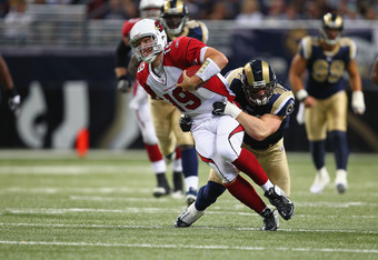 ST. LOUIS, MO - NOVEMBER 27: Chris Long #91 of the St. Louis Rams tackles John Skelton #19 of the Arizona Cardinals at the Edward Jones Dome on November 27, 2011 in St. Louis, Missouri.  (Photo by Dilip Vishwanat/Getty Images)