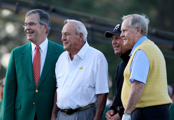 Augusta National Chairman Billy Payne poses for a photo-op with Arnold Palmer, Gary Player and Jack Nicklaus.