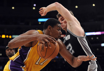 LOS ANGELES, CA - APRIL 17:  Andrew Bynum #17 of the Los Angeles Lakers drives on Tiago Splitter #22 of the San Antonio Spurs during the game at Staples Center on April 17, 2012 in Los Angeles, California.  NOTE TO USER: User expressly acknowledges and ag