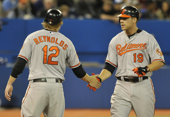 TORONTO, CANADA - APRIL 14:  Mark Reynolds #12 and Chris Davis #19 of the Baltimore Orioles celebrate a home run during MLB game action against the Toronto Blue Jays April 14, 2012 at Rogers Centre in Toronto, Ontario, Canada. (Photo by Brad White/Getty I