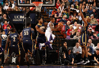 SACRAMENTO, CA - JANUARY 18:  Isaiah Thomas #22 of the Sacramento Kings drives to the basket against the Indiana Pacers at Power Balance Pavilion on January 18, 2012 in Sacramento, California. NOTE TO USER: User expressly acknowledges and agrees that, by