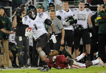 STANFORD, CA - NOVEMBER 12:  Josh Huff #1 of the Oregon Ducks breaks a tackle and goes fifty nine yards for a touchdown against the Stanford Cardinal at Stanford Stadium on November 12, 2011 in Stanford, California.  (Photo by Thearon W. Henderson/Getty I