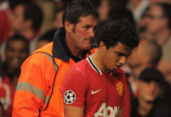 MANCHESTER, ENGLAND - SEPTEMBER 27:  Fabio Da Silva of Manchester United is substituted during the UEFA Champions League Group C match between Manchester United and FC Basel at Old Trafford on September 27, 2011 in Manchester, England.  (Photo by Michael