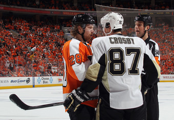 PHILADELPHIA, PA - APRIL 15: Claude Giroux #28 of the Philadelphia Flyers and Sidney Crosby #87 of the Pittsburgh Penguins go toe-to-toe prior to fighting during the first period in Game Three of the Eastern Conference Quarterfinals during the 2012 NHL St