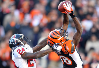CINCINNATI, OH - DECEMBER 11:  A.J. Green #18 of the Cincinnati Bengals catches a pass while defended by Johnathan Joseph #26 of the Houston Texans during the NFL game at Paul Brown Stadium on December 11, 2011 in Cincinnati, Ohio.  (Photo by Andy Lyons/G