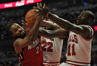 CHICAGO, IL - APRIL 12: Ronny Turiaf #21 of the Miami Heat battles for a rebound with Taj Gibson #22 and Ronnie Brewer #11 of the Chicago Bulls at the United Center on April 12, 2012 in Chicago, Illinois. NOTE TO USER: User expressly acknowledges and agre