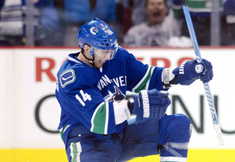 VANCOUVER, CANADA - APRIL 11: Alexandre Burrows #14 of the Vancouver Canucks celebrates after scoring against the Los Angeles Kings during the first period in Game One of the Western Conference Quarterfinals during the 2012 NHL Stanley Cup Playoffs at Rog