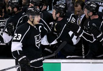 LOS ANGELES, CA - APRIL 15:  Dustin Brown #23 of the Los Angeles Kings celebrates with his teammates on the bench after scoring the game's only goal against the Vancouver Canucks in Game Three of the Western Conference Quarterfinals during the 2012 NHL St