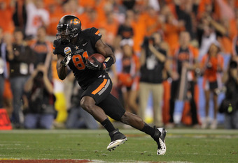 GLENDALE, AZ - JANUARY 02:  Justin Blackmon #81 of the Oklahoma State Cowboys catches a 67-yard touchdown reception in the second quarter against the Stanford Cardinal during the Tostitos Fiesta Bowl on January 2, 2012 at University of Phoenix Stadium in