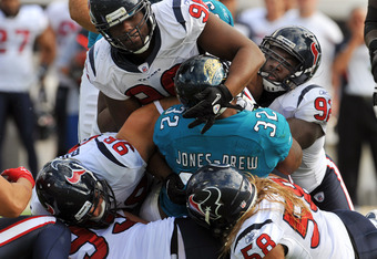 JACKSONVILLE, FL - NOVEMBER 27:  The defense of the Houston Texans piles on running back Maurice Jones-Dew #32 of the Jacksonville Jaguars November 27, 2011 at EverBank Field in Jacksonville, Florida. The Texans won 20 - 13. (Photo by Al Messerschmidt/Get