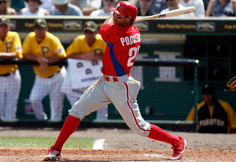 BRADENTON, FL - MARCH 16:  Outfielder Scott Podsednik #22 of the Philadelphia Phillies fouls off a pitch against the Pittsburgh Pirates during a Grapefruit League Spring Training Game at McKechnie Field on March 16, 2011 in Bradenton, Florida.  (Photo by