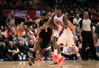 NEW YORK, NY - APRIL 15: LeBron James #6 of the Miami Heat drives against Iman Shumpert #21 of the New York Knicks at Madison Square Garden on April 15, 2012 in New York City. NOTE TO USER: User expressly acknowledges and agrees that, by downloading and/o