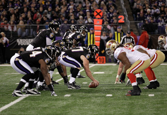 BALTIMORE, MD - NOVEMBER 24: The Baltimore Ravens offense lines up against the San Francisco 49ers defense at M&T Bank Stadium on November 24, 2011 in Baltimore, Maryland.  (Photo by Rob Carr/Getty Images)