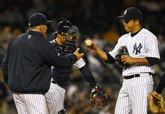 NEW YORK, NY - APRIL 18:  Hiroki Kuroda #18 of the New York Yankees is pulled from the game in the fifth inning by Manager Joe Girardi during their game against the Minnesota Twins on April 18, 2012 at Yankee Stadium in the Bronx borough of New York City.