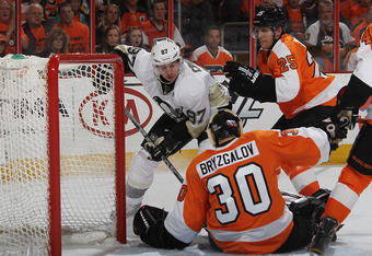 PHILADELPHIA, PA - APRIL 18: Ilya Bryzgalov #30 of the Philadelphia Flyers stops Sidney Crosby #87 of the Pittsburgh Penguins in the first period in Game Four of the Eastern Conference Quarterfinals during the 2012 NHL Stanley Cup Playoffs at Wells Fargo