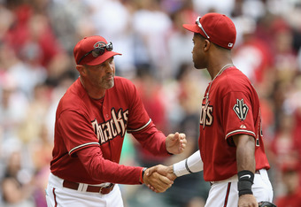 PHOENIX, AZ - APRIL 08:  Manager Kirk Gibson #23 of the Arizona Diamondbacks congratulates Chris Young #24 after defeating the San Francisco Giants in the MLB game at Chase Field on April 8, 2012 in Phoenix, Arizona. The Diamondbacks defeated the Giants 7