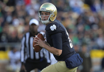 SOUTH BEND, IN - OCTOBER 29:  Tommy Rees #11 of the Notre Dame Fighting Irish looks for a receiver against the Navy Midshipmen at Notre Dame Stadium on October 29, 2011 in South Bend, Indiana. Notre Dame defeated Navy 56-14.  (Photo by Jonathan Daniel/Get