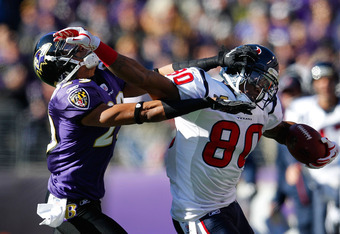 BALTIMORE, MD - JANUARY 15:   Andre Johnson #80 of the Houston Texans fights to maintain possession of the ball against Cary Williams #29 of the Baltimore Ravens during the first quarter of the AFC Divisional playoff game at M&T Bank Stadium on January 15