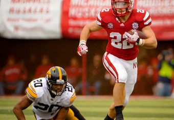 LINCOLN, NE - NOVEMBER 25: Running back Rex Burkhead #22 of the Nebraska Cornhuskers tries to get by linebacker Christian Kirksey #20 of the Iowa Hawkeyes during their game at Memorial Stadium November 25, 2011 in Lincoln, Nebraska. Nebraska defeated Iowa