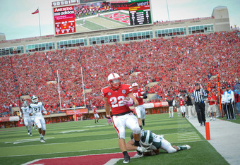 LINCOLN, NE - OCTOBER 29: Running back Rex Burkhead #22 of the Nebraska Cornhuskers scores a second half touchdown against the Michigan State Spartans defense during their game at Memorial Stadium October 29, 2011 in Lincoln, Nebraska.  Nebraska defeated