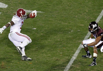 STARKVILLE, MS - NOVEMBER 12:  running back Trent Richardson #3 of the Alabama Crimson Tide cuts away from defensive back Wade Bonner #7 of the Mississippi State Bulldogs on November 12, 2011 at Davis Wade Stadium in Starkville, Mississippi. Alabama won 2
