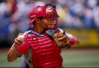 9 Jul 1998:  Catcher Ivan Rodriguez #7 of the Texas Rangers in action during a game against the Oakland Athletics at the Oakland Coliseum in Oakland, California.  The Rangers defeated the Athletics 4-1. Mandatory Credit: Otto Greule Jr.  /Allsport