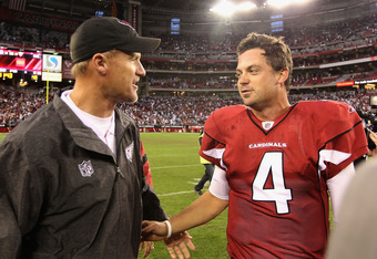 GLENDALE, AZ - DECEMBER 04:  Quarterback Kevin Kolb #4 of the Arizona Cardinals talks with head coach Ken Whisenhunt after defeating the Dallas Cowboys in the NFL game at the University of Phoenix Stadium on December 4, 2011 in Glendale, Arizona. The Card