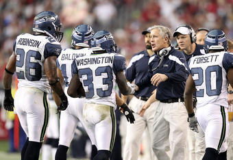GLENDALE, AZ - JANUARY 01:  Head coach Pete Carroll of the Seattle Seahawks congratulates Leon Washington #33 after scoring a touchdown during the NFL game against the Arizona Cardinals at the University of Phoenix Stadium on January 1, 2012 in Glendale,