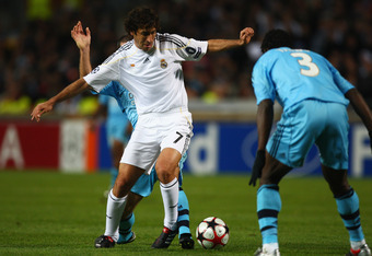 MARSEILLE, FRANCE - DECEMBER 08:  Raul Gonzalez of Real cuts between Benoit Cheyrou (l) and Taye Taiwo (r) during the Marseille v Real Madrid UEFA Champions League Group C match at the Stade Velodrome on December 8, 2009 in Marseille, France.  (Photo by M