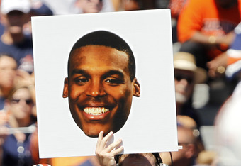 AUBURN, AL - SEPTEMBER 10:  Quarterback Clint Moseley #15 of the Auburn Tigers holds up a play card with Cameron Newton's face on it in the first half on September 10, 2011 at Jordan-Hare Stadium in Auburn, Alabama. (Photo by Butch Dill/Getty Images)