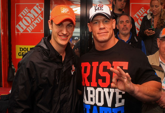 DAYTONA BEACH, FL - FEBRUARY 26:  Joey Logano (L), driver of the #20 The Home Depot Toyota, poses with professional wrestler John Cena in the garage area prior to the start of the NASCAR Sprint Cup Series Daytona 500 at Daytona International Speedway on F