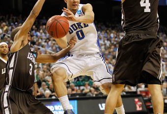 GREENSBORO, NC - MARCH 16:  Austin Rivers #0 of the Duke Blue Devils passes the ball between C.J. McCollum and John Adams #4 of the Lehigh Mountain Hawks in the second half during the second round of the 2012 NCAA Men's Basketball Tournament at Greensboro