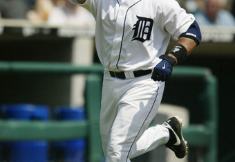 DETROIT - AUGUST 8:  Ivan Rodriguez #7 of the Detroit Tigers points to the sky as he runs to the plate after hitting a solo home run against the Boston Red Sox in the first inning of the game on August 8, 2004 at Comerica Park in Detroit, Michigan.  The R