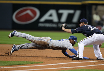 Milwaukee, WI - APRIL 18:  Matt Kemp #27 of the Los Angeles Dodgers dives back to first base to avoid the tag from Mat Gamel #24 of Milwaukee Brewers during the game at Miller Park on April 18, 2012 in Milwaukee, Wisconsin. (Photo by Mike McGinnis/Getty I