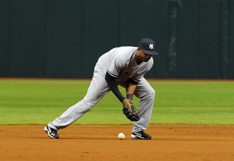 ST. PETERSBURG, FL - APRIL 7: Infielder Eduardo Nunez #26 of the New York Yankees bobbles an infield hit for an error against the Tampa Bay Rays April 7, 2012  at Tropicana Field in St. Petersburg, Florida.  (Photo by Al Messerschmidt/Getty Images)