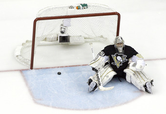 PITTSBURGH, PA - APRIL 13:  Marc-Andre Fleury #29 of the Pittsburgh Penguins reacts after giving up a goal in the third period against the Philadelphia Flyers in Game Two of the Eastern Conference Quarterfinals during the 2012 NHL Stanley Cup Playoffs at