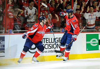 WASHINGTON, DC - APRIL 19:  Marcus Johansson #90 celebrates with Brooks Laich #21 of the Washington Capitals after scoring a goal against the Boston Bruins in Game Four of the Eastern Conference Quarterfinals during the 2012 NHL Stanley Cup Playoffs at Ve