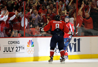 WASHINGTON, DC - APRIL 19:  Alexander Semin #28 celebrates with Alex Ovechkin #8 of the Washington Capitals after scoring a goal against the Boston Bruins in Game Four of the Eastern Conference Quarterfinals during the 2012 NHL Stanley Cup Playoffs at Ver