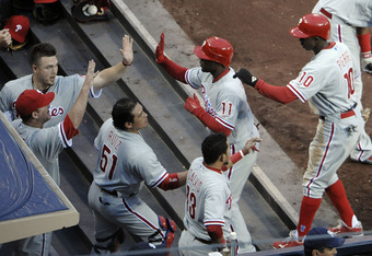 SAN DIEGO, CA - APRIL 19:  Juan Pierre #10 of the Philadelphia Phillies and Jimmy Rollins #11 are congratulated after Pierre scored during the first inning of a baseball game against the San Diego Padres at Petco Park on April 19, 2012 in San Diego, Calif