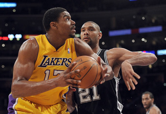 LOS ANGELES, CA - APRIL 17:  Andrew Bynum #17 of the Los Angeles Lakers turns to the basket in front of Tim Duncan #21 of the San Antonio Spurs at Staples Center on April 17, 2012 in Los Angeles, California.  NOTE TO USER: User expressly acknowledges and