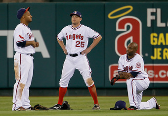 ANAHEIM, CA - SEPTEMBER 02:  (L-R) Vernon Wells #10, Peter Bourjos #25 and Torii Hunter #48 of the Los Angeles Angels of Anaheim wait for a pitching change in the eighth inning against the Minnesota Twins at Angel Stadium of Anaheim on September 2, 2011 i