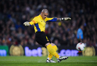 BARCELONA, SPAIN - MARCH 31:  Victor Valdes of FC Barcelona kicks the ball during the La Liga match between FC Barcelona Athletic Club at Camp Nou on March 31, 2012 in Barcelona, Spain. FC Barcelona won 2-0.  (Photo by David Ramos/Getty Images)