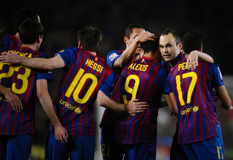 BARCELONA, SPAIN - APRIL 10:  Andres Iniesta of FC Barcelona (2ndR) celebrates after Alexis Sanchez of FC Barcelona scored the opening goal during the La Liga match between FC Barcelona and Getafe CF at Camp Nou on April 10, 2012 in Barcelona, Spain. FC B