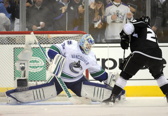 LOS ANGELES, CA - APRIL 18:  Cory Schneider #35 of the Vancouver Canucks stops Dustin Brown #23 of the Los Angeles Kings on a penalty shot during the third period at Staples Center on April 18, 2012 in Los Angeles, California.  (Photo by Harry How/Getty I