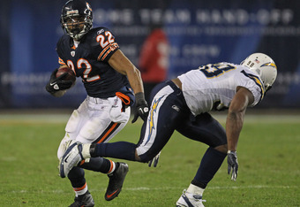 CHICAGO, IL - NOVEMBER 20: Matt Forte #22 of the Chicago Bears runs past Antwan Barnes #98 of the San Diego Chargers at Soldier Field on November 20, 2011 in Chicago, Illinois. The Bears defeated the Chargers 31-20. (Photo by Jonathan Daniel/Getty Images)