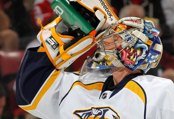DETROIT, MI - APRIL 17: Pekka Rinne #35 of the Nashville Predators takes a drink during a break i play while playing the Detroit Red Wings in Game Four of the Western Conference Quarterfinals during the 2012 NHL Stanley Cup Playoffs at Joe Louis Arena on